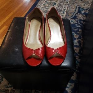 Red open toe shoes with a slight wedge